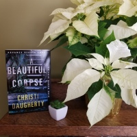A Beautiful Corpse by Christi Daugherty #bookreview #tarheelreader #thrbeautifulcorpse @cj_daugherty @minotaurbooks @stmartinspress #abeautifulcorpse #bookbestiesabeautifulcorpse