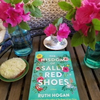 The Wisdom of Sally Red Shoes by Ruth Hogan #bookreview #tarheelreader #thrssallyredshoes @ruthmariehogan @crookedlanebks #thewisdomofsallyredshoes